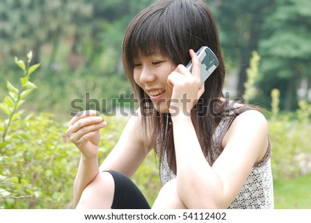 Asian girl on cell phone - stock photo