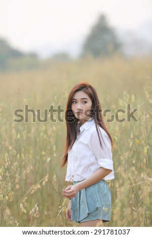 Asian girl on wheat field