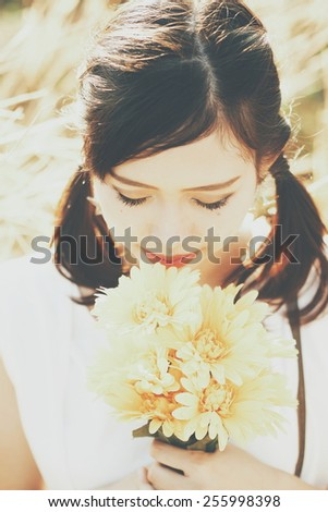Asian girl outdoor portrait in vintage warm color filter