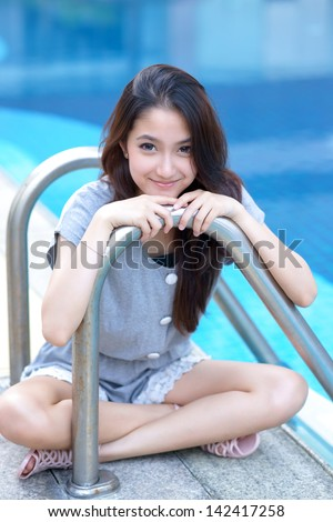 Asian girl portrait on swimming pool