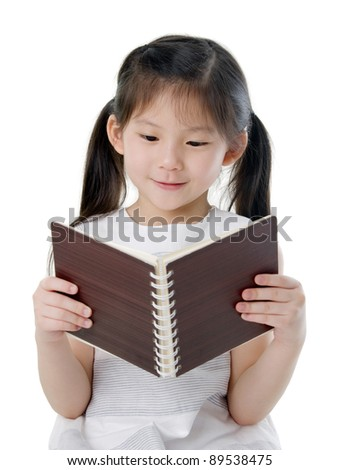 asian girl reading - stock photo