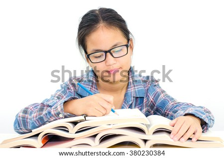asian girl reading book with studying for test - Education and school concept  - stock photo