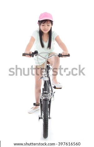 Asian girl riding a bike on white background isolated - stock photo