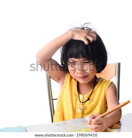 Asian girl scratching her head - stock photo