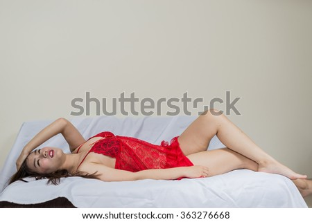 asian girl sexy wearing red dress on the sofa