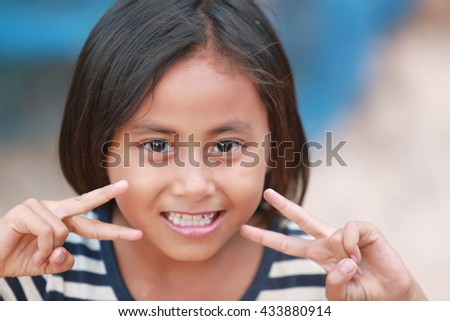 Asian girl smiling happy outdoor,summer - stock photo
