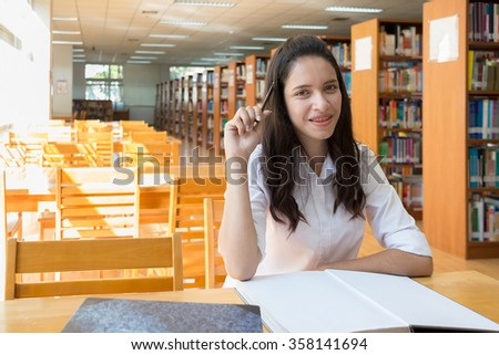 Asian girl student sudying at the library , Reading on the table