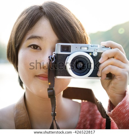 Asian Girl Taking Pictures By Camera Concept