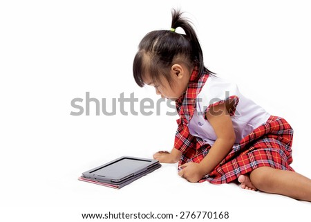 Asian girl using a tablet pc isolated ,back to school  - stock photo