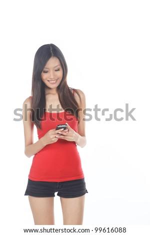 Asian Girl Using Mobile Phone on White Background - stock photo