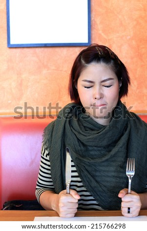 Asian Girl Waiting for Lunch