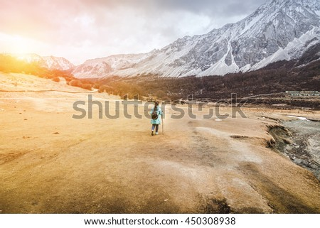 asian girl walinkg alone with dry grass field travel concept