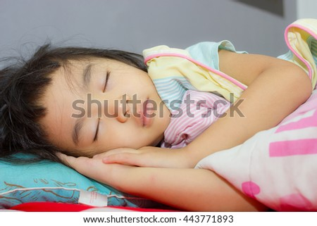 Asian girl was asleep ,her sick.