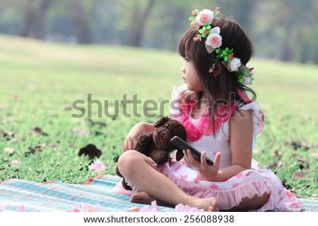 Asian girl was watching via wireless in mobile phone - stock photo