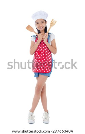 Asian girl wearing apron and holding cooking utensil - stock photo