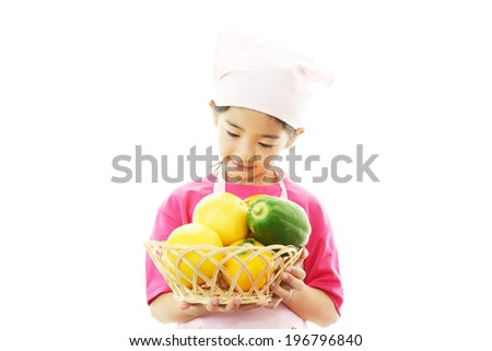 Asian girl wearing kitchen apron - stock photo