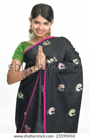 Asian girl with black silk-sari in welcome posture - stock photo
