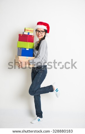 asian girl with christmas gift and santa hat