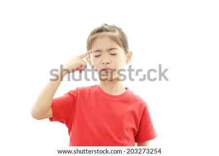 Asian girl with headache - stock photo