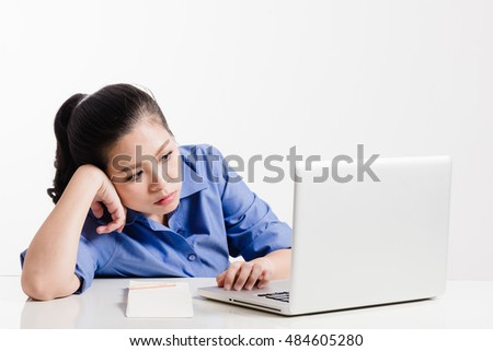 Asian girl with notebook computer books and pencil on white background
