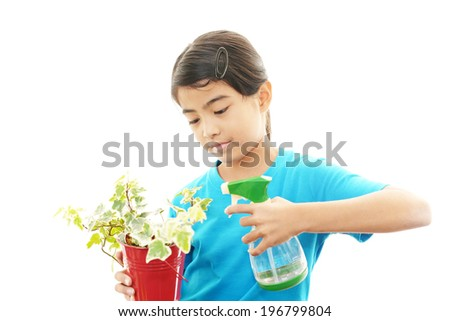 Asian girl with plant - stock photo