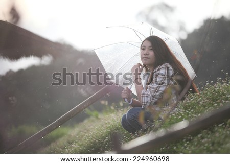 asian girl with rain - stock photo