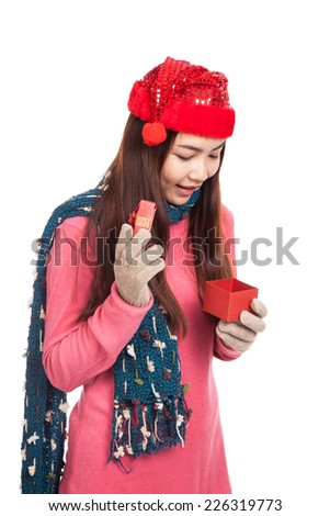 Asian girl with red christmas hat look inside a gift box  isolated on white background