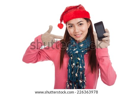 Asian girl with red christmas hat point to mobile phone  isolated on white background
