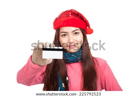 Asian girl with red christmas hat smile show credit card  isolated on white background