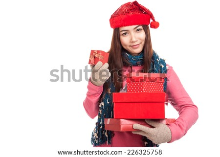 Asian girl with red christmas hat with many gift boxes  isolated on white background