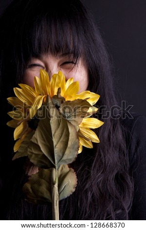 Asian girl with sunflower - stock photo