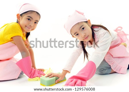 Asian girls cleaning - stock photo