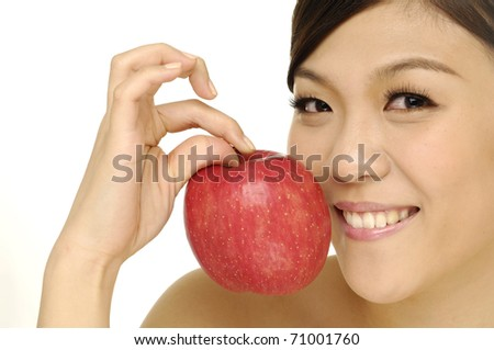 Asian girls holding apples on hands