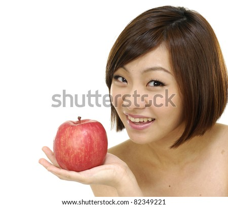 Asian girls holding apples on hands - stock photo