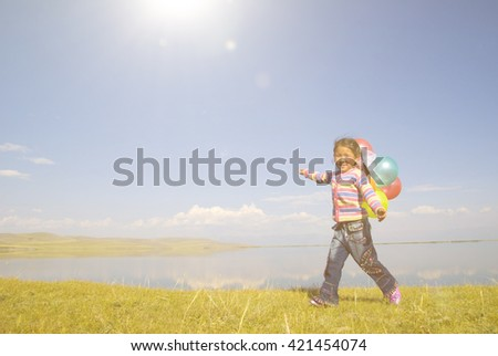 Asian Girls Playing by a Lake Concept - stock photo