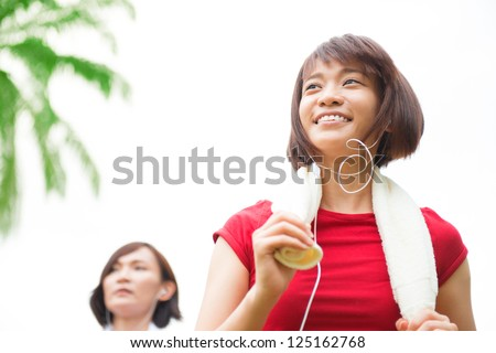 Asian girls running at outdoor park - stock photo