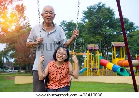 Asian Grandfather posing with grandchildren - stock photo