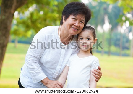 Asian grandmother and grandchild at outdoor - stock photo
