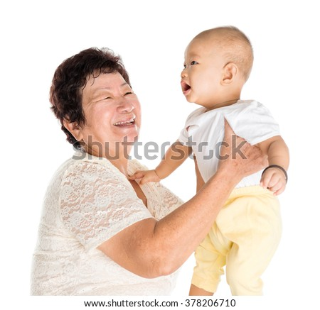 Asian grandmother and grandchild portrait, isolated on white background. - stock photo