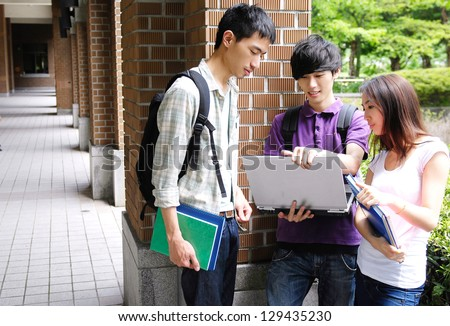 Asian group student with notebook at a campus - stock photo