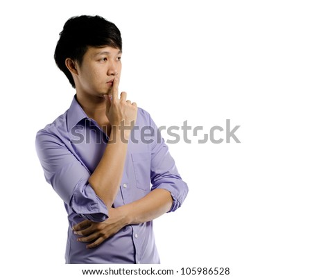 Asian guy thinking and looking to the empty space side