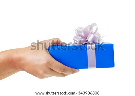 Asian hand giving a gift wrapped in blue box with silver ribbon and bow. the most beautiful gift isolated on white background - stock photo
