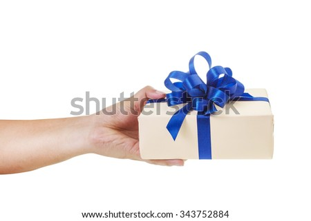 Asian hand giving a gift wrapped in nude color box with blue ribbon and bow. the most beautiful gift on white background - stock photo