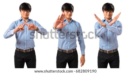 Asian handsome man with glasses making stop sign