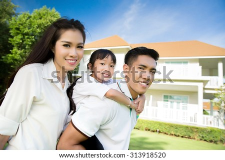 Asian happy family They are deciding to buy a home. Family concept - stock photo