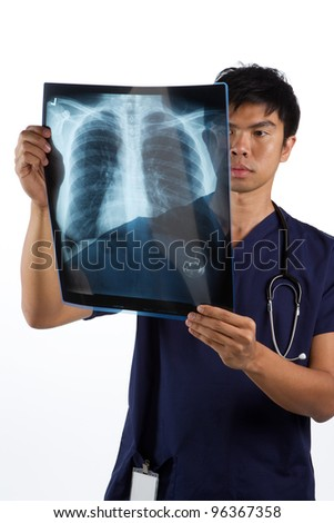Asian healthcare worker looking at an X-ray