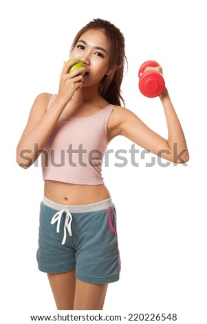 Asian healthy girl workout with dumbbell eat apple  isolated on white background