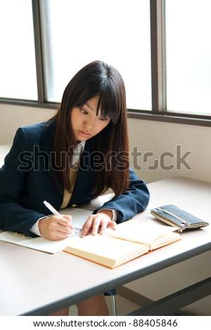 asian high schoolgirl studying - stock photo