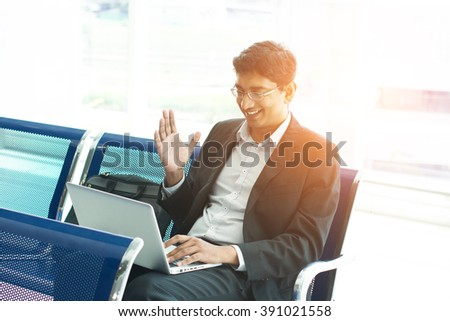 Asian Indian businessman using laptop computer