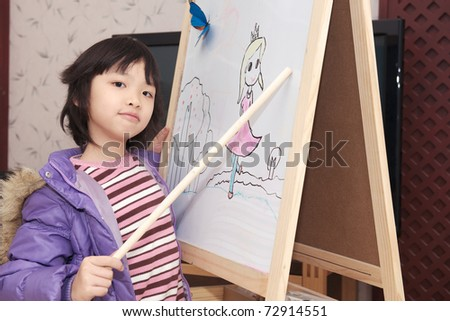 Asian kid acting as teacher on the white board - stock photo
